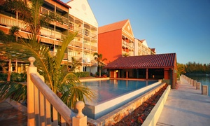 Pelican Bay Hotel Stay with Airfare from Vacation Express: ✈ Pelican Bay Hotel Stay with Airfare. Price per Person Based on Double Occupancy (Buy 1 Groupon per Adult Traveler).