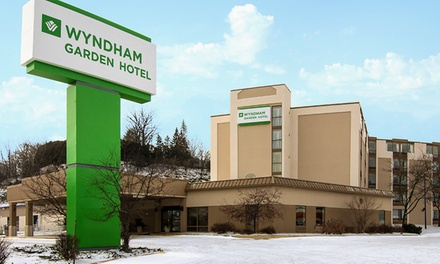groupon daily deal - Stay at the Wyndham Garden Rochester in Rochester, MN. Dates into August.