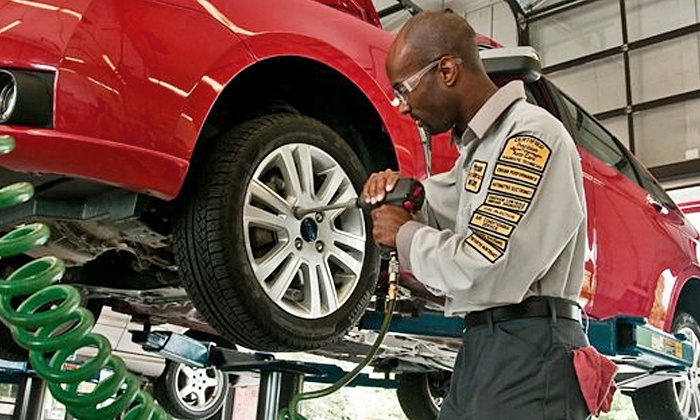 Precision Tune Auto Care - Delray Beach: $25 for Premium Oil-Change Package with Tire Rotation and Brake Inspection at Precision Auto Care (Up to $106 Value)
