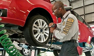 Precision Tune Auto Care: $25 for Premium Oil-Change Package with Tire Rotation and Brake Inspection at Precision Auto Care (Up to $106 Value)