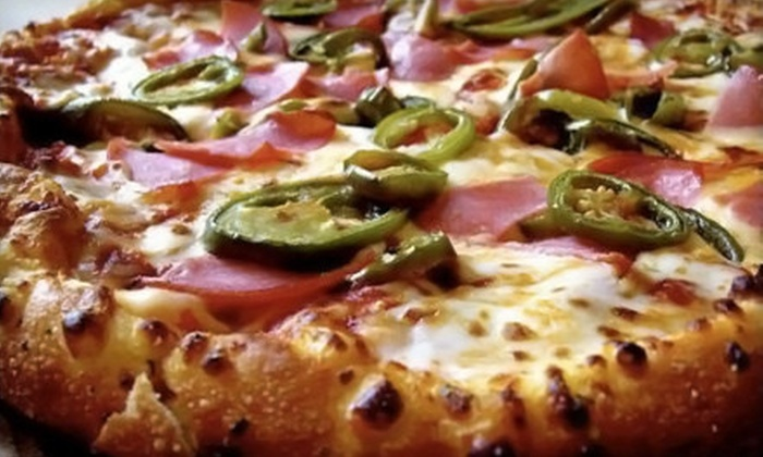 Domino's Pizza - New Haven: New Pan Pizza, Parmesan Bread Bites, and Soda for Four or Two at Domino's Pizza (Up to 54% Off)