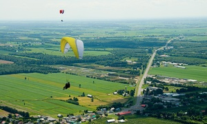 X Fly: Tandem Paragliding or Towed Hang-Gliding Flight for One with X Fly (Up to 57% Off)