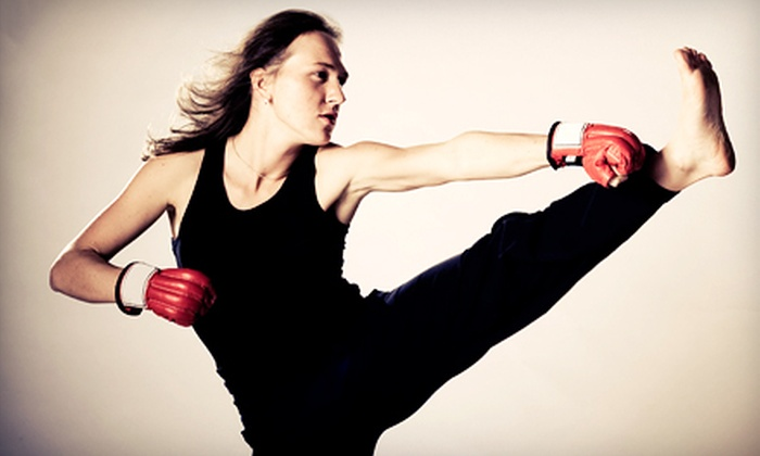 CKO Kickboxing - Totowa: 5 Kickboxing Classes or 10 Kickboxing Classes with Pair of Gloves at CKO Kickboxing (Up to 71% Off)