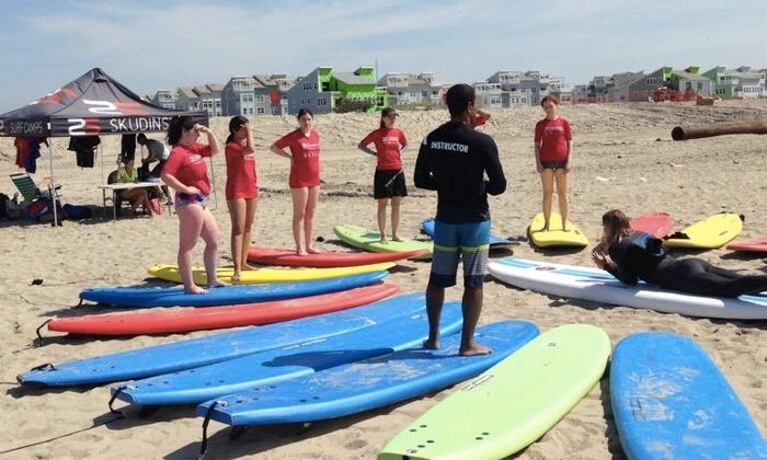 Rockaway Beach Trip or Surf Lessons - 85 Delancey St.: Rockaway Beach Shuttle with Optional Surf Lessons & Board Rental