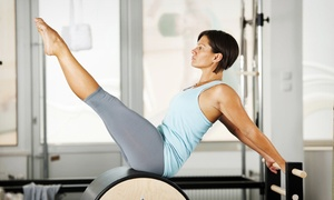 Center of Gravity Pilates: Four or Eight Semi-Private Pilates Classes at Center of Gravity Pilates