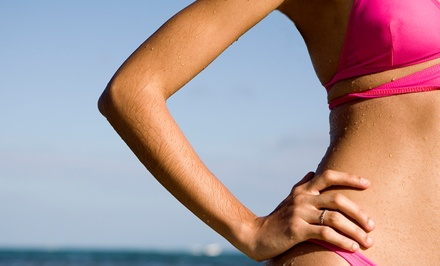 One or Three Fit Body Wraps at Golden Caribbean Tan (Up to 77% Off)