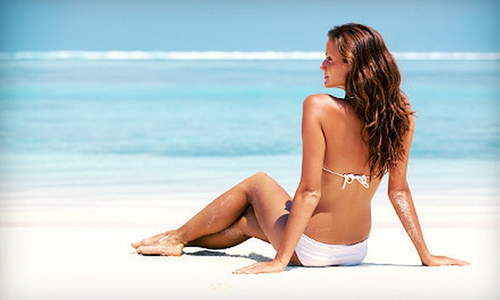 Ultimate Tan & Spa - Schwegler: 1, 3, or 5 Custom Spray Tans or 10 Tanning-Bed Sessions at Ultimate Tan & Spa (Up to 57% Off)