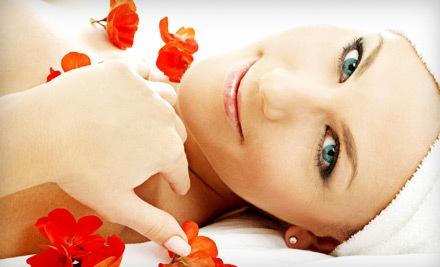 1 Loving Lotus Massage or 1 Signature Facial - Loving Lotus Center & Spa in Coral Springs