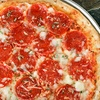 C$10 for Pizza and Italian Cuisine at Milano Pizzeria