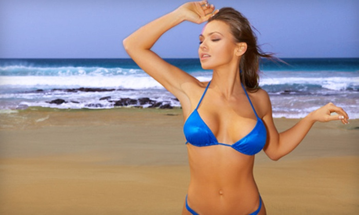Xclusive Tan - Multiple Locations: Three Red-Light RenuvaSkin Treatments or Three Mystic Tans at Xclusive Tan (Up to 68% Off)