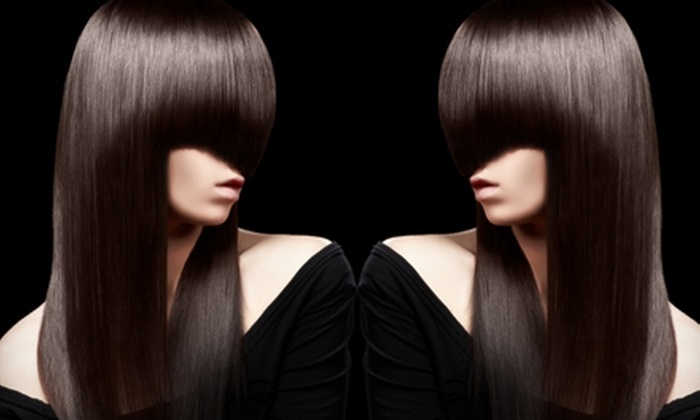 Ethan Douglas Paul Mitchell Salon - Downtown Reno: $20 for a Haircut and Blow-Dry (Up to $40 Value) or Awapuhi Deep Conditioning Treatment ($45 Value) at Ethan Douglas Paul Mitchell Salon