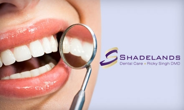 Dr. Ricky Singh, DMD - Multiple Locations: $59 for an Exam, X-Rays, and Cleaning ($275 Value) or $159 for an Exam, X-Rays, Cleaning, and a Take-Home Whitening Kit ($575 Value) from Dr. Ricky Singh, DMD