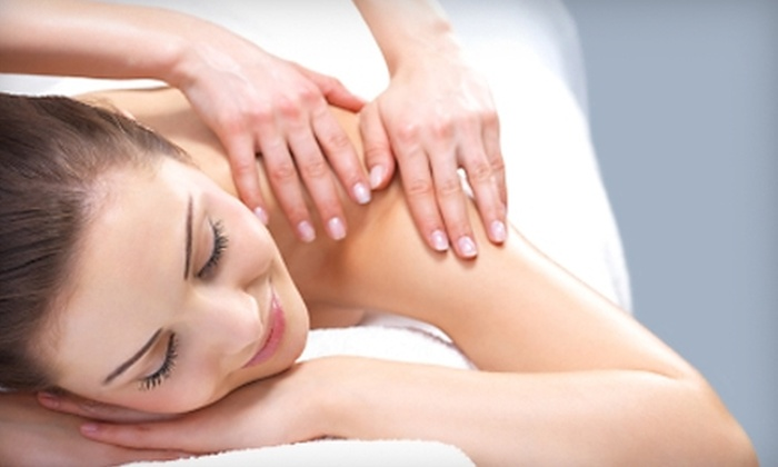 Slossberg Chiropractic & Wellness - Hypoluxo Village West: $29 for a Consultation and One-Hour Therapeutic Massage at Slossberg Chiropractic & Wellness in Lake Worth ($70 Value)