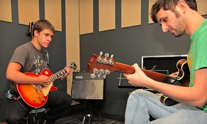 School of Rock - Hosford - Abernethy: $50 for Four Introductory Music Lessons at School of Rock