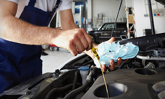 Sam's Automotive - Oakland Park: Oil Change with Windshield-Wiper Replacement or Alignment, Brake Inspection, and Tire Rotation at Sam's Automotive in Oakland Park (Up to 70% Off)