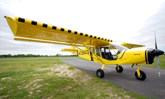 Pilot Coach Academy - Sanford: $99 for Intro Flight Lesson, Commemorative Photo, DVD, Simulator Time, and Logbook at Pilot Coach Academy in Sanford ($149 Value)