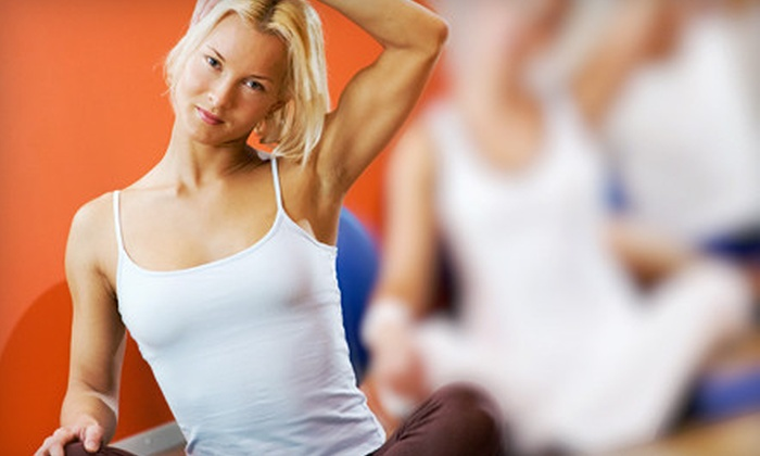 Hard Core Pilates and Yoga - Greenwood Village: 10 Yoga Classes or Month of Unlimited Yoga Classes at Hard Core Pilates and Yoga in Greenwood Village (Up to 71% Off)