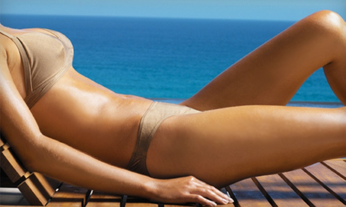 Darque Tan - Multiple Locations: UV- or Sunless-Tanning Sessions at Darque Tan (Up to 83% Off). Three Options Available.