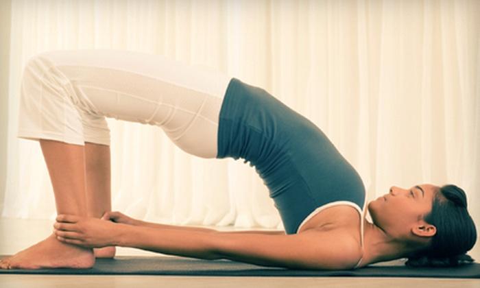 Santosha - Santosha Yoga: 6 or 12 Yoga Classes at Santosha (Up to 87% Off)