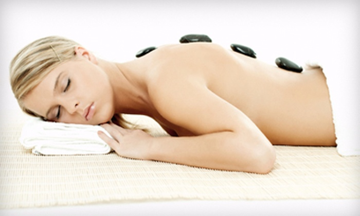 The Atmosphere Salon and Spa - Barclay: Spa Day for Two or Hot-Stone Massage for One at The Atmosphere Salon and Spa