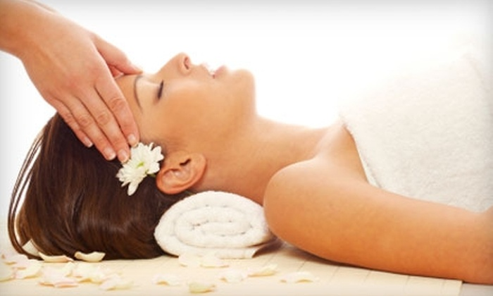 Peace of Mind Massage Therapy & Natural Healing - Central City: $55 for a One-Hour Wine Therapy Massage ($120 Value) or $27 for a Fire & Ice Facial ($55 Value) at Peace of Mind Massage Therapy & Natural Healing