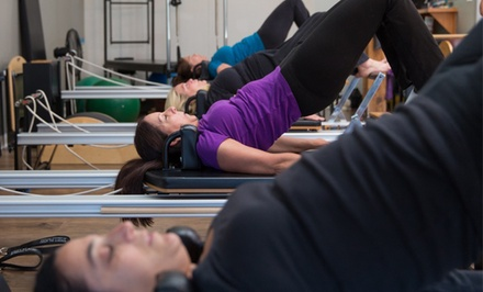 Yoga and Pilates Mat and Equipment Classes at Align Pilates Center (Up to 67% Off). Three Options Available.