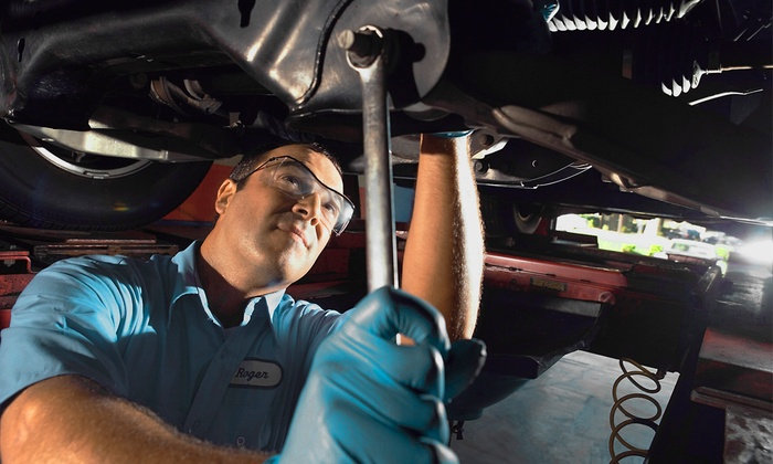 Dania Motors - Dania Beach: Wheel Alignment or Two Oil Changes and Tire Rotation with Inspection at Dania Motors (Up to 46% Off)