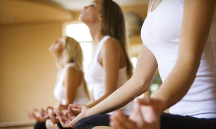 Barefoot Studio - Tucson: $60 for One Month of Unlimited Yoga Plus a Massage or Facial at Barefoot Studio (Up to $145 Value)