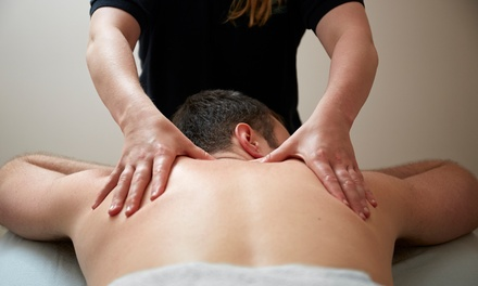 Chiropractic Exam and One, Three, or Five Therapeutic Massages at Dallas Wellness Center (Up to 80% Off)
