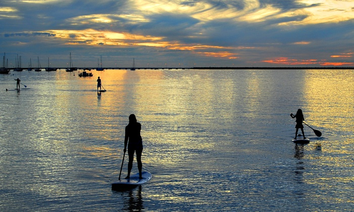 PureSUP Yoga - Huntington Beach: SUP Yoga Class with Boards for One or Two, or Private Class for Up to Four with PureSUP Yoga (Up to 53% Off)