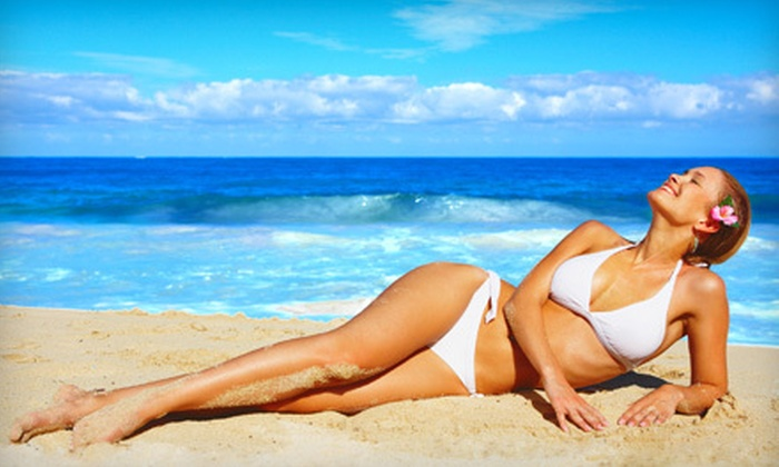 Tiki Tanning - Multiple Locations: One Month of Unlimited UV Tanning or Two Custom Airbrush Tans at Tiki Tanning (Up to 65% Off)