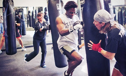 $49 for Two Weeks of Boxing and Kickboxing Classes with Gloves and Hand Wraps at Title Boxing Club ($124.99 Value)