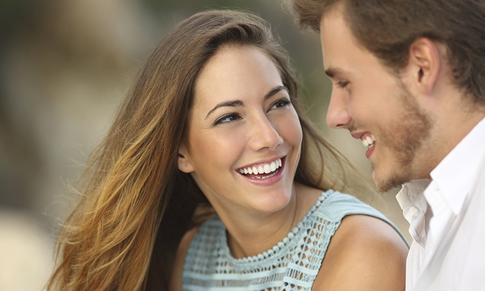 American Dental Center of Eatontown - Multiple Locations: Invisalign or Braces with Take-Home Whitening Kit at American Dental Center of Eatontown (Up to 97% Off)
