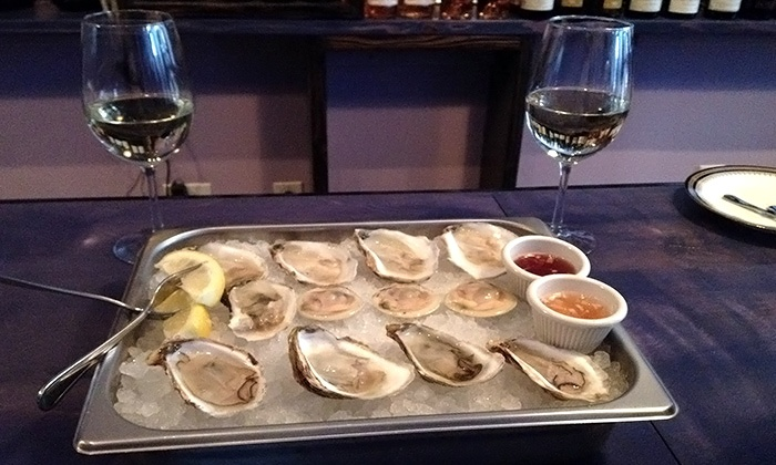 Northeast Oyster Co. - Mamaroneck: $30 for One Dozen Oysters and Two Glasses of Wine at Northeast Oyster Co. (Up to $50.50 Value)