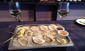 Northeast Oyster Co.: $30 for One Dozen Oysters and Two Glasses of Wine at Northeast Oyster Co. (Up to $50.50 Value)