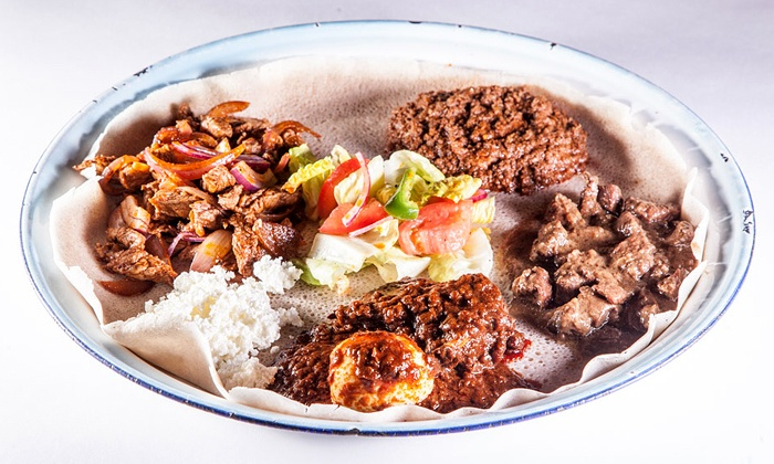 Abay Ethiopian Restaurant - Montlake: $15 for $25 Worth of Ethiopian Cuisine for Dinner at Abay Ethiopian Restaurant