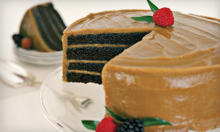 Caroline's Cakes - Cape St. Claire: Nine-Inch Red Velvet or Chocolate Four-Layer Cake from Caroline's Cakes (Half Off)
