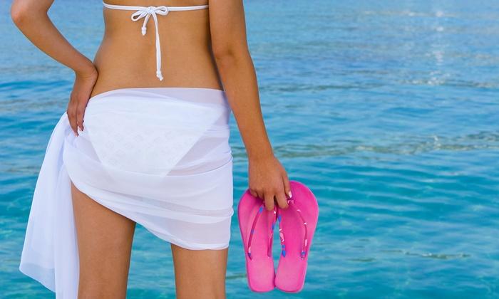 Total Tan - Saint Clair Shores: $39.99 for Three VersaSpa UV Spray Tans at Total Tan ($80 Value)