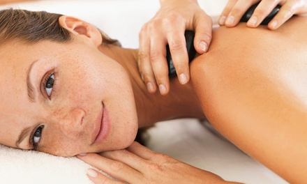 Hot Stone, Swedish or Aromatherapy Massage or Hot Stone Massage and Facial at Holistically Whole (Up to 54%* Off)