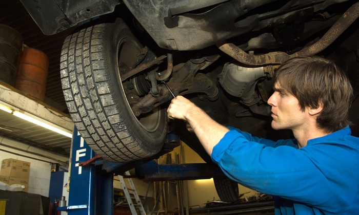 Dulles Automotive Service Center - Dulles: Front Brake Pads, Rear Brake Pads, or Both; or Four-Wheel Alignment at Dulles Automotive Service Center (Up to 63% Off)