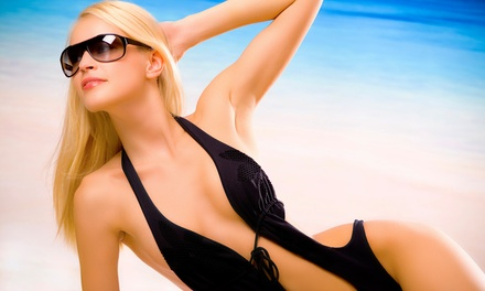 One Month of Unlimited UV Tanning or Two VersaSpa Spray Tans at Sol'exotica Tanning Spa (Up to 61% Off)