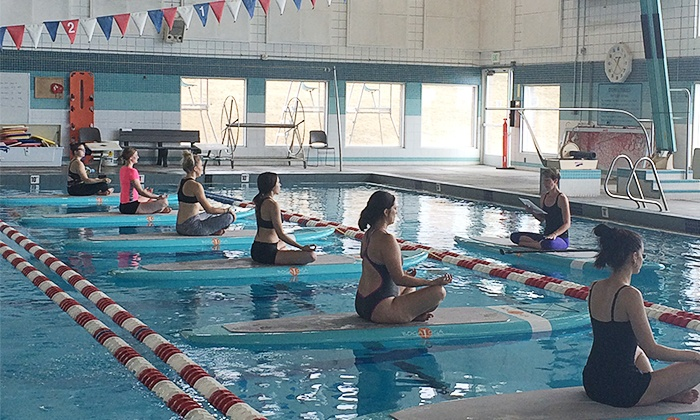 Divine Wellness - Salt Lake City: One or Five Paddle Board Yoga Class for One or Two at Divine Wellness (Up to 57% Off)