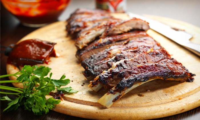 Texas Pit Bar-B-Que - Texas Pit Bar B Que: BBQ Meal for Two, BBQ Package for up to Twelve, or Catering Package at Texas Pit Bar-B-Que (Up to 51% Off)