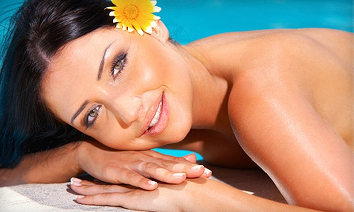 Boca Tanning Club - Multiple Locations: One or Three Spray Tans or Three Bed or Booth Sessions at Boca Tanning Club (Up to 67% Off)