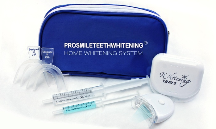 Pro Smile Teeth Whitening - Koll Business Center - West Downtown: $25 for a Take-Home Whitening Kit with Lifetime Refills from Pro Smile Teeth Whitening ($149 Value)
