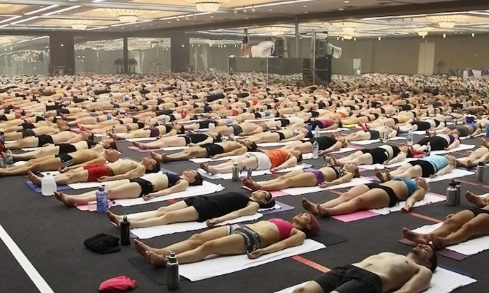 Bikram Yoga Orlando - Colonial Town Center: $55 for One Month of Unlimited Classes for New Clients at Bikram Yoga Orlando ($150 Value)