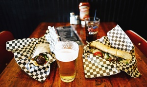 The Racket Bar and Pinball Lounge: Philly Cheesesteak or Falafel Dinner for Two or Four at The Racket (56% Off)