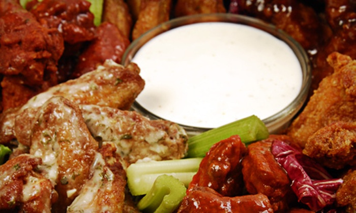 Bonfire Wings - Oak Forest - Garden Oaks: $30 for a Family Sports Pack with Wings, Fries, and Cajun Boudain Balls at Bonfire Wings ($60.80 Value)
