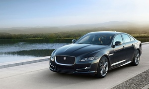 Premium Luxury by Damon: From $49 for a Chauffeured Jaguar Transfer Service for up to Four People with Premium Luxury by Damon (From $88 Value)