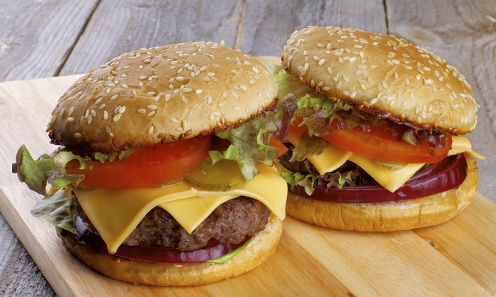 Corral Drive In - Long Beach: One Burger and Side with Purchase of 2 Burgers and 2 Sides at Corral Drive In